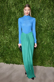 Martha Hunt sported a cool mix of colors with this green maxi skirt and blue turtleneck combo.