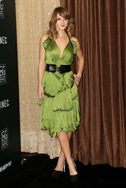 Beau brightened up the red carpet at the CDG Awards in an olive green chiffon cocktail dress. She belted the look with black leather.