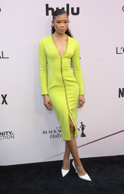 Storm Reid cut a slim silhouette in a form-fitting neon-yellow dress by Sergio Hudson at the 2020 Essence Black Women in Hollywood Awards.