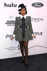 Janelle Monae finished off her look with black patent platform pumps.