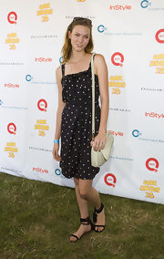 Karlie Kloss attended the Super Saturday event carrying a simple yet stylish nude leather shoulder bag.