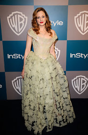 Andrea Riseborough made a statement at the Golden Globes in a corseted sage evening dress with a sheer skirt.
