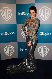 Lea Michele added shine to her provocative gown with a glittery black box clutch.