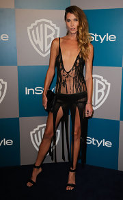 Erin Wasson topped off her sexy look with black strappy sandals.