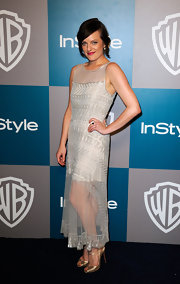 Elisabeth Moss topped off her sheer ensemble with metallic Mary Jane peep-toe pumps.