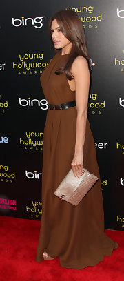 Eva Mendes teamed her olive halter dress with a metallic gold leather Cicely clutch.