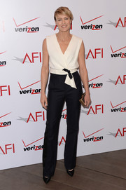 Robin Wright Penn opted for a pair of satin-trimmed black slacks to complete her look.