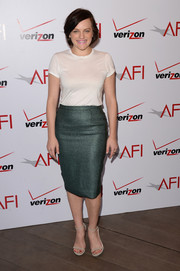 Elisabeth Moss made up for her too-casual top with a stylish teal jacquard skirt by Nonoo.