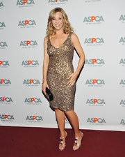 Julie sparkled in a gold cocktail dress at the ASPCA event.