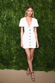 Martha Hunt showed off her supermodel figure in a body-con Cushnie et Ochs LWD with capelet detailing at the CFDA/Vogue Fashion Fund Awards.