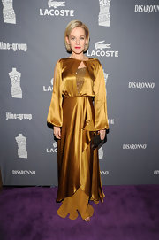 Penelope Ann Miller wore this bronze silk gown to the Costume Designers Guild Awards.