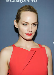 Amber Valletta swept on a rich matte red lipstick for the 14th Annual Costume Designers Guild Awards.