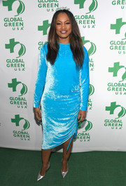 Garcelle Beauvais attended the Global Green pre-Oscar party looking bright in a sky-blue velvet dress.
