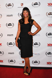 Aisha Tyler chose this sleek and slender LBD that featured a stylish peplum top for her look at the Golden Trailer Awards.