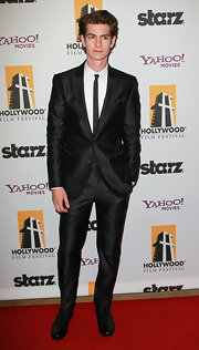 Andrew is decked out in Dolce and Gabbana with his elegant black sheen suit, white collared shirt and skinny dotted tie.