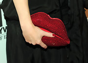 Helena showed off a sparkling Swarovski Lips Clutch while attending the 14th Annual Hollywood Gala.