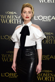 Amber Heard looked modern in a white cold-shoulder pussybow blouse by Ralph & Russo at the 2019 L'Oreal Paris Women of Worth Awards.