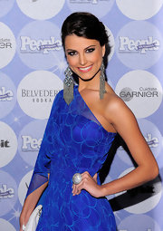 Stefania showed off her large diamond earrings while at the 50 Most Beautiful event.