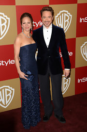 Susan Downey carried an embellished satin clutch in the same shade of blue as her dress during the Golden Globes after-party.