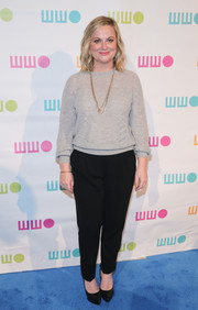 Amy Poehler attended the Worldwide Orphans Gala dressed down in a gray sweater and black slacks.