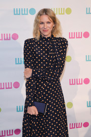 Naomi Watts accessorized with an elegant navy satin clutch at the Worldwide Orphans Gala.