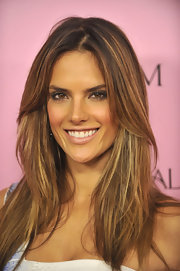 Alessandra paired her light lip with a saturated smoky eye.