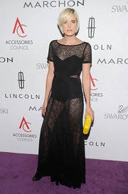 Model tomboy, Agyness Deyn, turned heads at the ACE Awards in a sheer black gown.