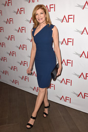 Rene Russo complemented her sexy dress with stylish black strappy sandals.
