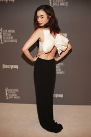 We are head over heels for this gorgeous bowed gown Lily wore to the Costume Designers Guild Awards.