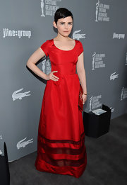 Ginnifer Goodwin made a dramatic yet modest statement in this striking red cap-sleeve dress at the Costume Designers Guild Awards.