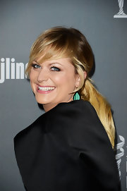 A low ponytail with bangs glammed up Amy Poehler's red carpet look at the Costume Designers Guild Awards.