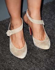 Kristen Wiig opted for nude ankle strap pumps to complete her red carpet look at the 2013 Costume Designers Guild Awards.