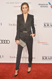 Anja Rubik complemented her outfit with a black Saint Laurent croc-embossed clutch.