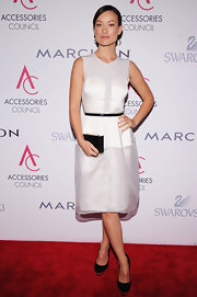 Olivia Wilde went for a minimal look at the ACE Awards in this white dress with black accessories.