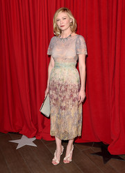 Kirsten Dunst looked retro chic in a watercolored print sheer dress at the AFI Awards.