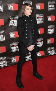 Kodi Smit-McPhee arrived at the 16th Annual Critics' Choice Movie Awards wearing a black thigh-length epaulette military-inspired coat with metal buttons.