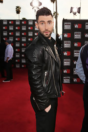 Adam looked tough in a leather motorcycle jacket at the Critic's Movie Awards.