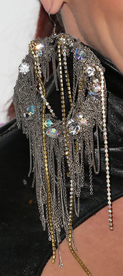 Jessica Sutta wore an extravagant pair of earrings which included diamonds and chain tassels at a pre-Grammy party.