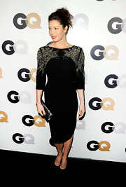 Jessica Biel accented her sequined velvet dress with a sleek black leather clutch.