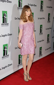 Bella Heathcote styled her pink petal-adorned shift with a shimmering silver pair of strappy stilettos.