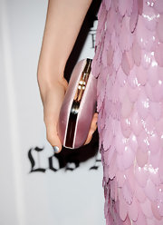 Bella Heathcote toned down her look's twinkle with a solid pink hard case clutch.