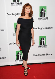 Susan Sarandon styled her off-the-shoulder LBD with black strappy sandals.
