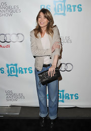 Ellen Pompeo carried a black leather envelope clutch to the Los Angeles Antique Show.
