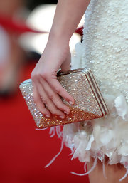 Marion carried a sparkling box clutch to the SAG Awards, which was a nice add on to her white beaded cocktail dress.