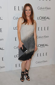 Julianne carries a small box clutch with silver trim.