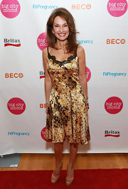 Susan Lucci rocked a gold fitted dress that featured a black lace neckline.