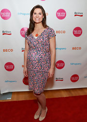 Krystal Ball opted for a delicately printed wrap dress for her look at the Big City Moms event in NYC.
