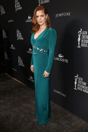 Amy Adams went for Old Hollywood elegance at the Costume Designers Guild Awards in a long-sleeve teal Frocktalk by Kristin Burke evening dress.