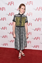 Claire Foy paired her dress with basic black ankle-strap sandals.