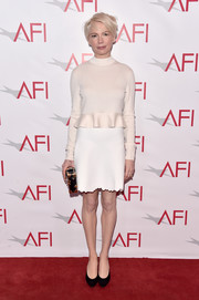 Michelle Williams paired her top with a white scallop-hem mini skirt, also by Louis Vuitton.